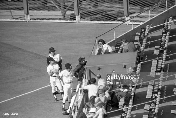 Wimbledon tennis champ, Billie Jean King, draws fans even from amongst the other pros as she attends the game between the San Francisco Giants and...