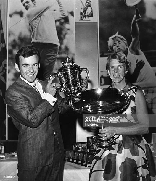 Wimbledon tennis champion Ann Jones and British Open golf champion Tony Jacklin with their trophies at the Savoy Hotel London after being named...
