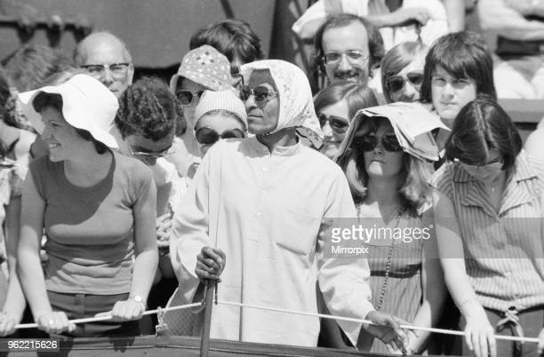 Wimbledon Tennis Championships Thursday 24th June 1976 Crowd Scenes during match spectators cover their heads from intense heat of sun