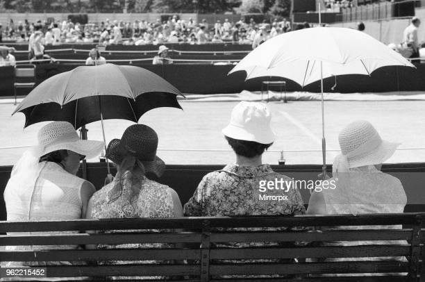 Wimbledon Tennis Championships Thursday 24th June 1976 spectators use their umbrellas for protection from harsh rays of sun during heatwave