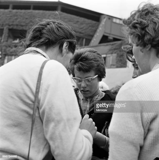 Wimbledon Tennis Ladies day Pictured Billie Jean Moffitt the player who beat Margaret Smith on the outside courts with the crowds signing autographs...