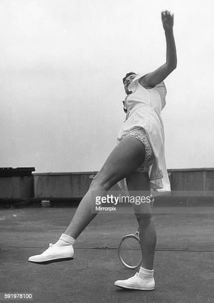 Wimbledon tennis star Gertrude 'Gussie' Moran showing off her new style dress and pants June 1949