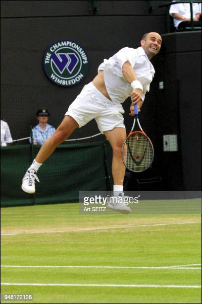 wimbledon uk july 4 2001 andre agassi serving to nicolas escude on court #l Agassi won in 4 sets 67 63 64 62