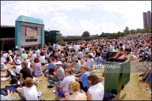 Wimbledon uk july 6 2001 fans on 'Henman hill' watching Rafter vs Agassi on large tv screen
