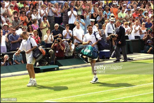wimbledon uk july 6 2001 semi final winner pat rafter smiles to his coach tony roche and girlfriend lara feldham as he walks off the center court...