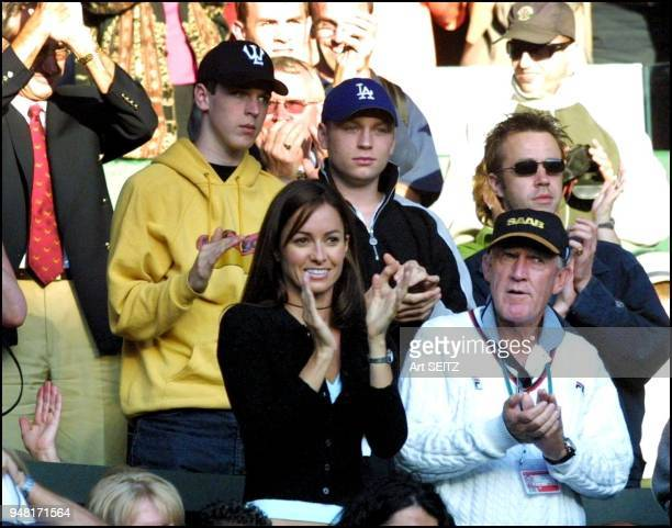 wimbledon uk june 30 2001 Team Rafter pat rafter's girlfriend lara feldham and coach tony roche respond to his victory over arazi photo by art seitz