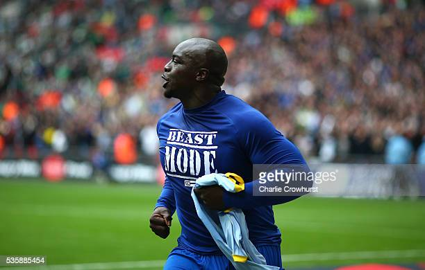 Wimbledon's Adebayo Akinfenwa celebrates after scoring the teams second goal from the penalty spot during the Sky Bet League 2 Play Off Final between...