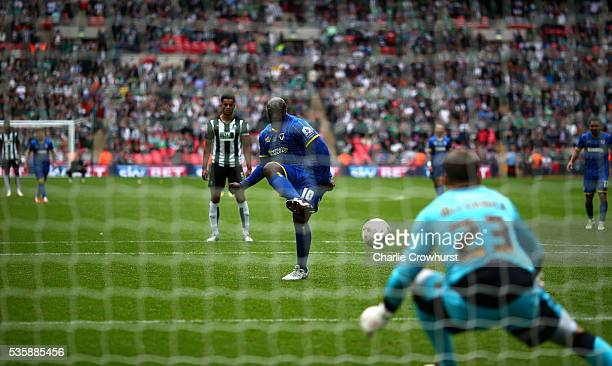 Wimbledon's Adebayo Akinfenwa scores the teams second goal from the penalty spot during the Sky Bet League 2 Play Off Final between Plymouth Argyle...