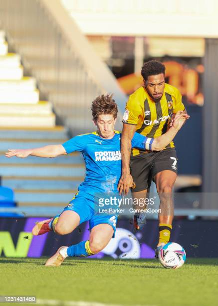 Wimbledon's Alex Woodyard challenges Hull City's Mallik Wilks and a penalty was given during the Sky Bet League One match between AFC Wimbledon and...