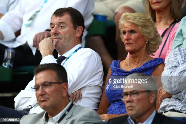 Wimbledon's All England Club chairman Philip Brook and his wife Gill Brook watch the women's singles final between Caroline Wozniacki of Denmark and...