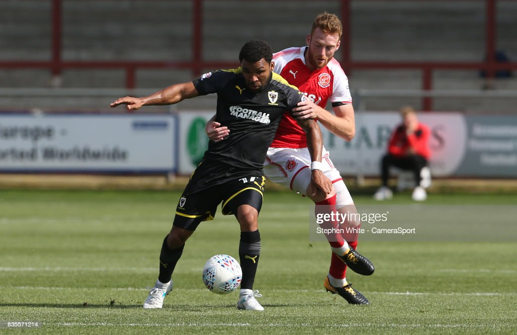 AFC Wimbledon's Andy Barcham shields the ball from Fleetwood Town's Cian Bolger during the Sky Bet League One match between Fleetwood Town and A.F.C. Wimbledon at Highbury Stadium on August 19, 2017 in Fleetwood, England.