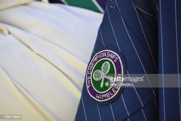 Wimbledon's emblem is seen on a line judge's jacket during men's singles first round match between Serbia's Janko Tipsarevic and Japan's Yoshihito...