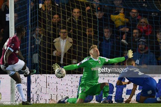 Wimbledon's English goalkeeper Aaron Ramsdale saves a shot from West Ham United's English midfielder Michail Antonio during the English FA Cup fourth...