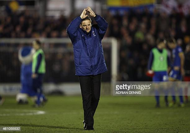 AFC Wimbledon's English manager Neal Ardley applauds their supporters after the English FA Cup third round football match between AFC Wimbledon and...