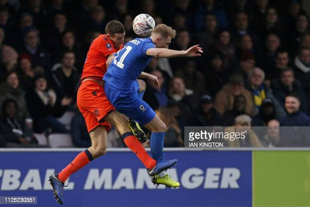 AFC Wimbledon's English midfielder Mitchell Pinnock vies with Millwall's Irish striker Aiden O'Brien during the English FA Cup fifth round football...