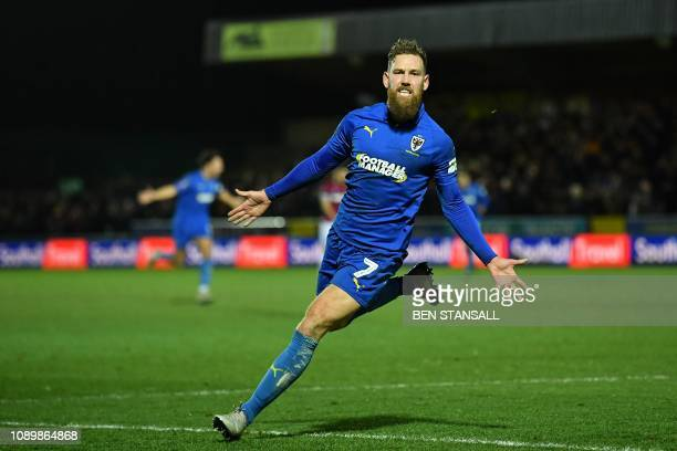 AFC Wimbledon's English midfielder Scott Wagstaff celebrates scoring their second goal during the English FA Cup fourth round football match between...