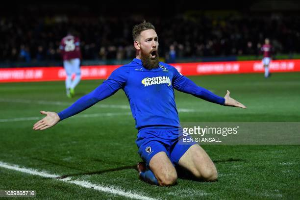 AFC Wimbledon's English midfielder Scott Wagstaff celebrates scoring their third goal during the English FA Cup fourth round football match between...