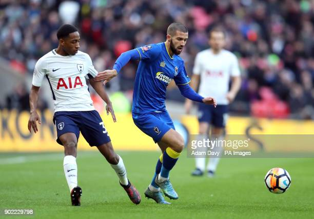 AFC Wimbledon's George Francomb and Tottenham Hotspur's Kyle WalkerPeters battle for the ball during the Emirates FA Cup Third Round match at Wembley...