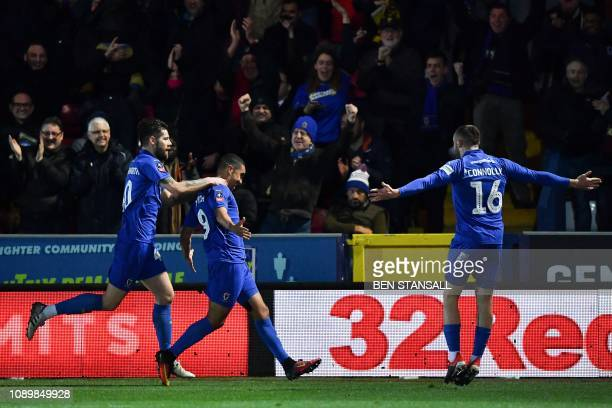 AFC Wimbledon's Ghanaian striker Kwesi Appiah celebrates scoring the opening goal during the English FA Cup fourth round football match between AFC...