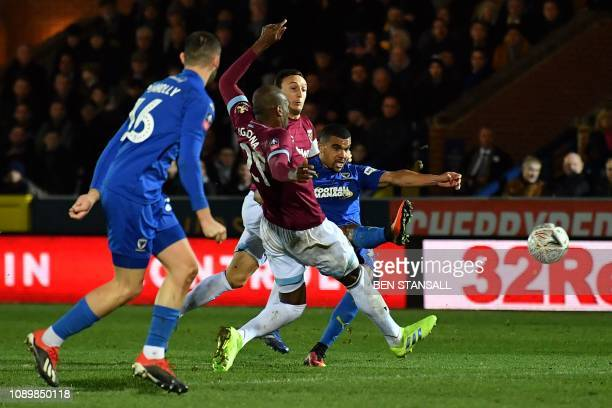 AFC Wimbledon's Ghanaian striker Kwesi Appiah scores the opening goal during the English FA Cup fourth round football match between AFC Wimbledon and...