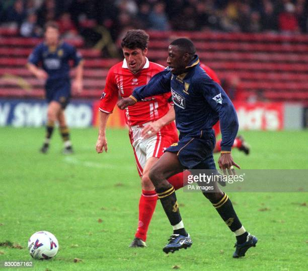 FEATURE Wimbledon's Jason Euell fights off Middlesborough's Andy Townsend during this afternoon's FA Carling Premiership calsh at Selhurst Park FInal...
