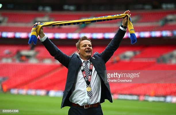 Wimbledon's manager Neal Ardley celebrates the teams win and promotion during the Sky Bet League 2 Play Off Final between Plymouth Argyle and AFC...