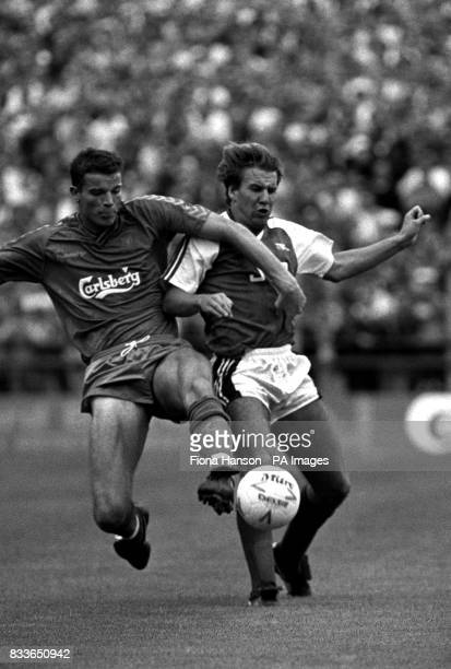 Wimbledon's Peter cawley and Arsenal's Paul Merson battle for the ball Arsenal went on to win 51 with Merson putting away his teams final goal after...