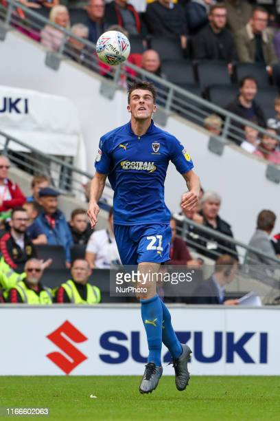 Wimbledon's Ryan Delaney heads the ball clear during the Sky Bet League 1 match between MK Dons and AFC Wimbledon at Stadium MK, Milton Keynes on...
