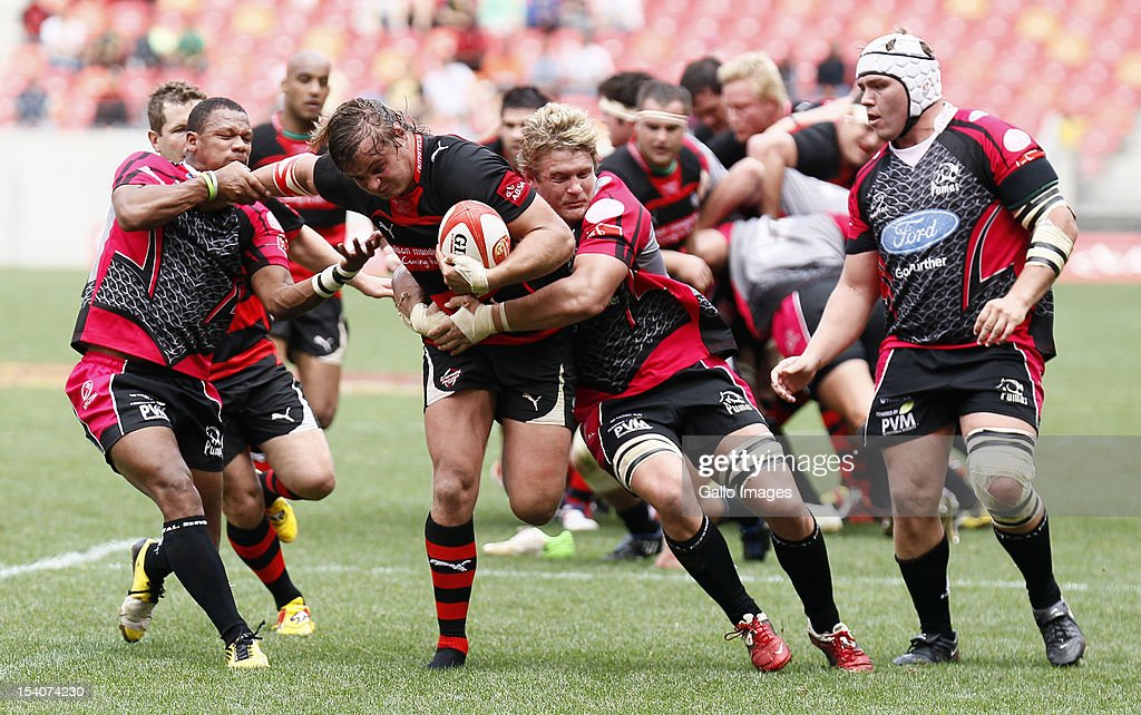 Wimpie van der Walt of the EP Kings attempts to break through the Ford Pumas defence during the Absa Currie Cup First Division final match between Eastern Province Kings and Ford Pumas at Nelson Mandela Bay Stadium on October 13, 2012 in Port Elizabeth, South Africa.