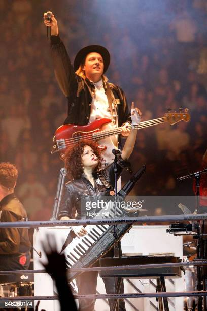 Win Butler and Regine Chassagne of Arcade Fire perform at Madison Square Garden on September 12 2017 in New York City