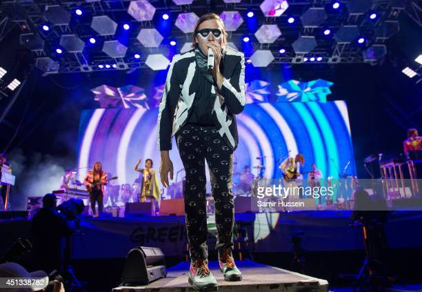 Win Butler of Arcade Fire performs as the band headline the Pyramid Stage on Day 1 of the Glastonbury Festival at Worthy Farm on June 27 2014 in...