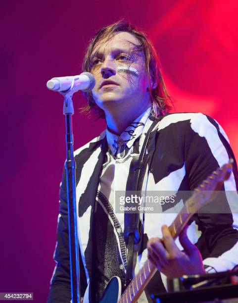 Win Butler of Arcade Fire performs at United Center on August 26 2014 in Chicago Illinois