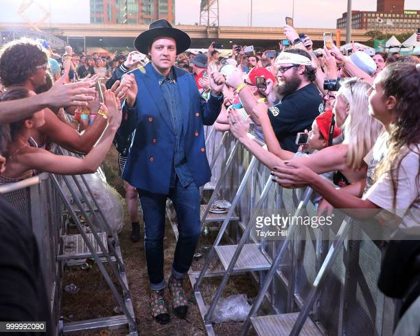 Win Butler of Arcade Fire performs marching through the crowd during the 2018 Forecastle Music Festival at Louisville Waterfront Park on July 15 2018...