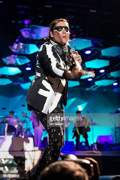 Win Butler of Arcade Fire performs on The Pyramid Stage during Day 1 of the Glastonbury Festival at Worthy Farm on June 27 2014 in Glastonbury England