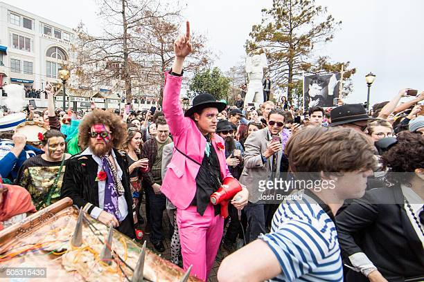 Win Butler of Arcade Fire takes part in a second line honoring David Bowie through the French Quarter on January 16 2016 in New Orleans Louisiana