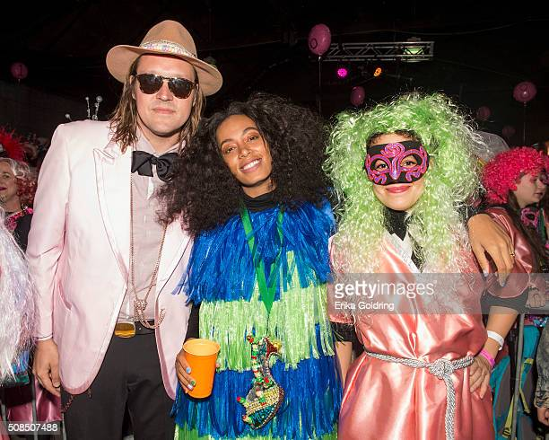 Win Butler of the band Arcade Fire Solange Knowles and Régine Chassagne of Arcade Fire gather for a photo at the Krewe of Muses preparade party on...