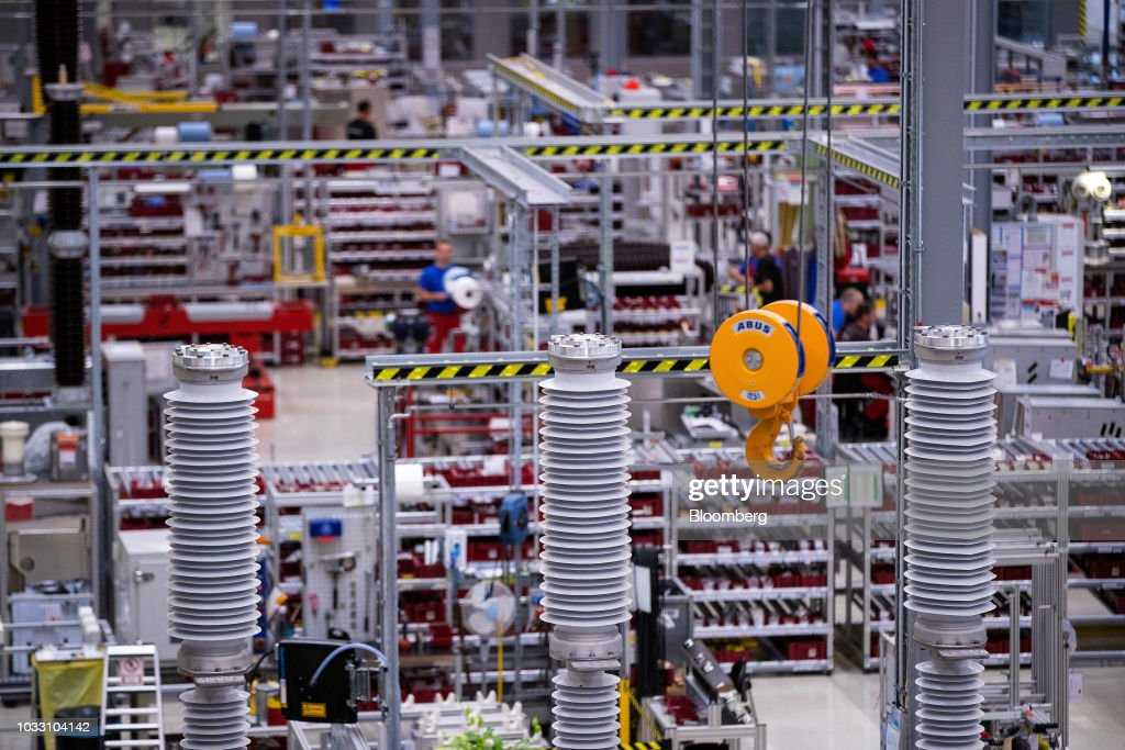 A winch hangs on the high voltage circuit breaker production line inside Siemens AG switchgear electronic power unit factory in Berlin, Germany, on Thursday, Sept. 13, 2018. Nearly one year afterSiemens unveiled a plan for massive jobs cuts at its struggling power and gas division, Chief Executive OfficerJoeKaesersaid talks with unions are nearing completion, clearing the way for a revamp of the business just as an industry slump deepens. Photographer: Krisztian Bocsi/Bloomberg via Getty Images