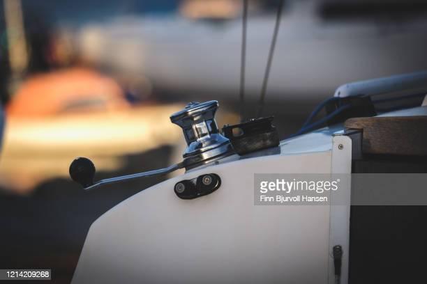 winch on a sailing boat, blurred background - finn bjurvoll stock-fotos und bilder