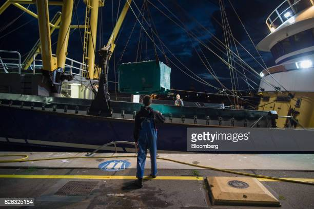 A winch unloads a fishing trawler's catch before sunrise at the port of Den Helder Netherlands on Friday Aug 4 2017 Prime Minister Theresa May will...