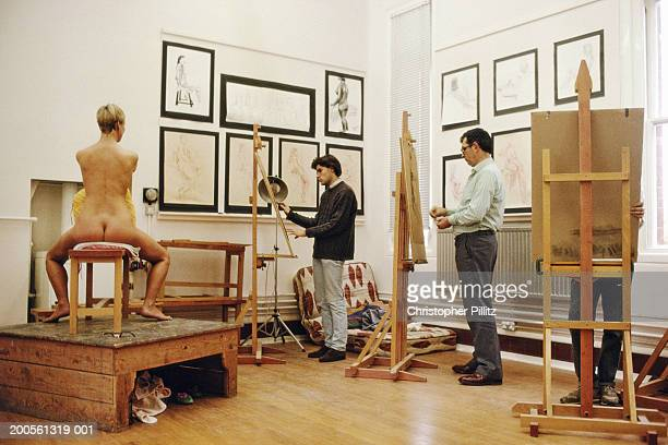 UK, Winchester College, Wiltshire, students painting nude model
