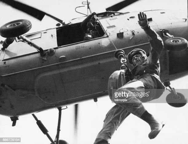 Winchman F~light Sergeant Tony Rodmell being lifted into a RAF Westland Whirlwind HAR10 helicopter of 202 Search and Rescue Squadron B Flight at RAF...
