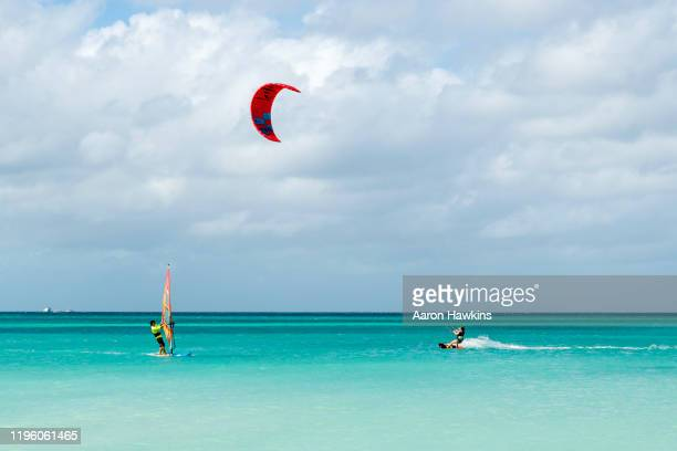 wind and kite surfers at hadicurari beach off the coast of aruba - antilles stock pictures, royalty-free photos & images