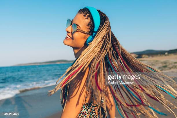 Wind and multicolored braided hair