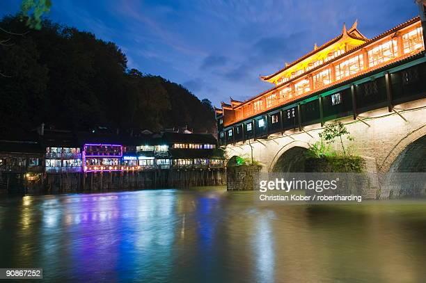 Wind and rain bridge illuminated at night, Fenghuang, Hunan Province, China, Asia