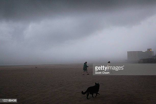 Wind and rain from Hurricane Irene chase visitors off the beach August 26, 2011 in Nags Head, North Carolina. Dare County, which includes the...