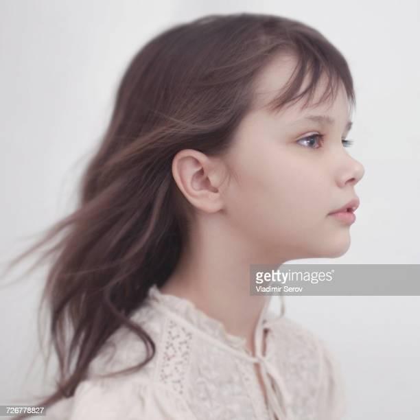 Wind blowing hair of Caucasian girl