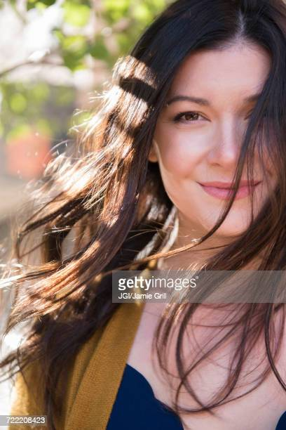 Wind blowing hair of Caucasian woman