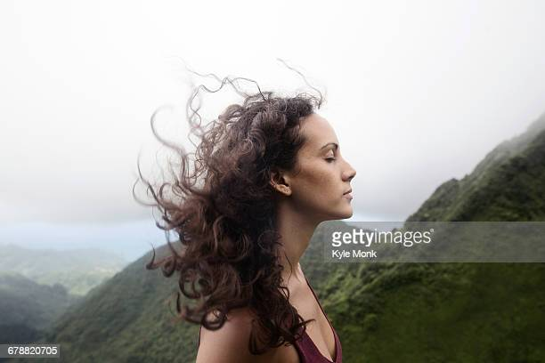 wind blowing hair of mixed race woman - eyes closed stock pictures, royalty-free photos & images