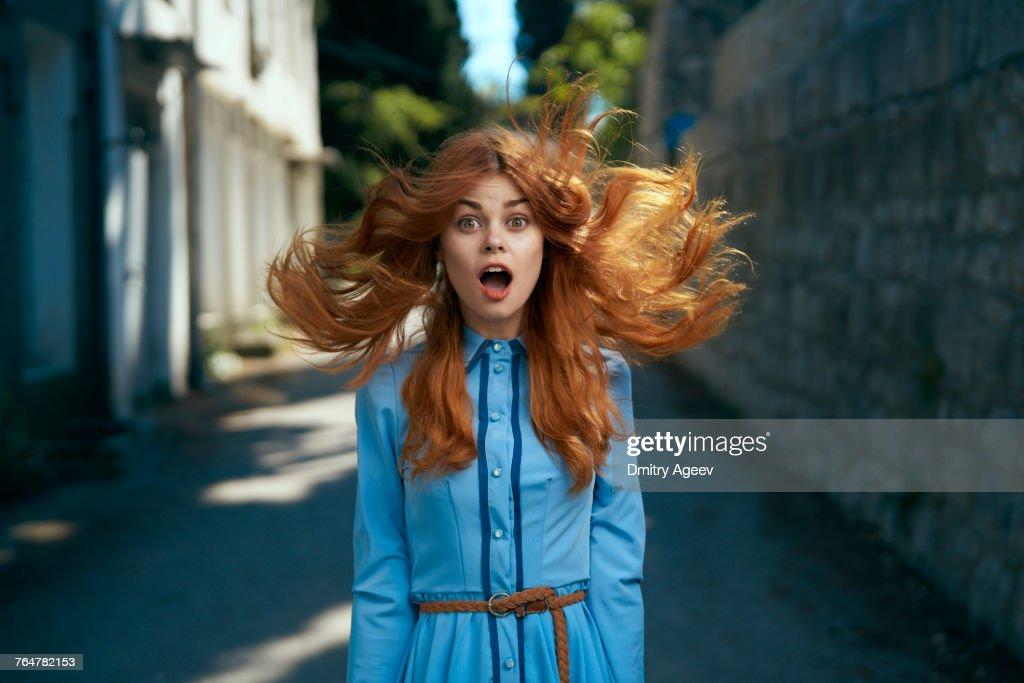 Wind blowing hair of surprised Caucasian woman : Foto de stock