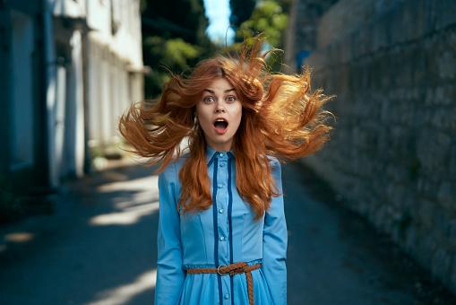 Wind blowing hair of surprised Caucasian woman - gettyimageskorea